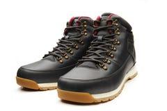 Donkere zwarte laarzen met schoenveter op witte achtergrond royalty-vrije stock foto's