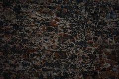 Donkere, zwarte, oude bakstenen muur Royalty-vrije Stock Foto