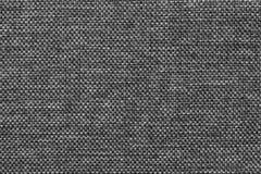 Donkergrijze achtergrond van dichte geweven in zakken doende stof, close-up Structuur van de textielmacro Stock Fotografie