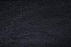 Donkergrijze zwarte leiachtergrond of textuur van natuursteen stock foto