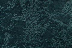 Donkergroene achtergrond van een zacht stofferings textielproduct, close-up Stock Foto's