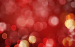 Donkerrode abstracte achtergrond met rode en gouden blurreslichten Stock Fotografie