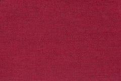 Donkerrode achtergrond van een textielproduct met rieten patroon, close-up Stock Foto's