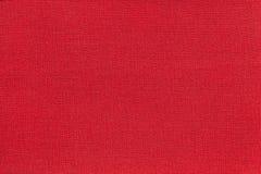 Donkerrode achtergrond van een textielproduct met rieten patroon, close-up Royalty-vrije Stock Afbeeldingen
