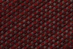 Donkerrode achtergrond van geruite patroontextiel, close-up Structuur van de rieten stoffenmacro Stock Foto