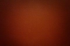 Donkerrode rode synthetische leerachtergrond met vignet Stock Afbeeldingen