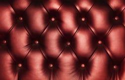 Donkerrode van leercapitone textuur als achtergrond Stock Foto