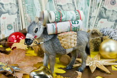 Donkey with big money - a christmas scene Stock Photos