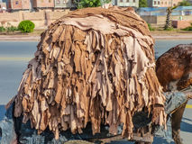Donkey carrying hides Royalty Free Stock Image