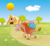 Donkey carrying load Royalty Free Stock Images
