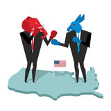 Donkey and elephant fight. Democrat and Republican opposition. B Royalty Free Stock Photography
