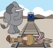 Donkey on the railroad tracks. Republican elephant has just finished tying democrat donkey to the railroad tracks Royalty Free Stock Photography