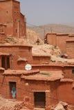 Man and donkey riding through Moroccan village Royalty Free Stock Image