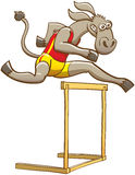 Donkey running and jumping over a hurdle Royalty Free Stock Image