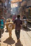 Donkey in a sidestreet in Jodhpur. Jodhpur, India,16th January 2017 - A  man with his donkey in a narrow sidestreet in Jodhpur, India Stock Photo