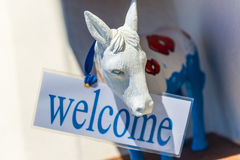 Donkey With Welcome Sign In Santorini Stock Image