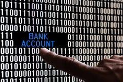 Données de compte bancaire d'indication par les doigts en code binaire Photographie stock