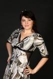 Donna abbastanza castana in vestito Fotografia Stock