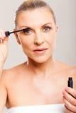 Metà di mascara della donna di età Fotografia Stock Libera da Diritti
