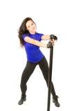 donna in abiti sportivi che risolve in ginnastica Fotografia Stock Libera da Diritti