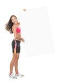 Donna adatta di forma fisica che mostra tabellone per le affissioni Immagine Stock Libera da Diritti