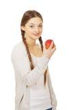 Donna adolescente che tiene una mela Fotografie Stock