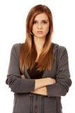 Donna adolescente preoccupata con le armi piegate Fotografia Stock Libera da Diritti