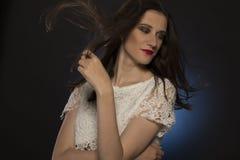 Donna adorabile con moto dei capelli allo studio Immagine Stock Libera da Diritti