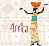 Donna africana in vestito etnico sul fondo dell'ornamento Fotografie Stock