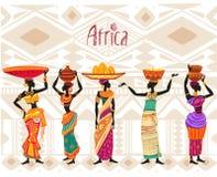 Donna africana in vestito etnico sul fondo dell'ornamento Fotografia Stock