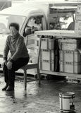 Donna al riposo. Woman in the fish market Stock Images