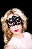 Donna alla moda nella maschera Immagine Stock