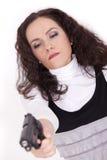 Donna alla tendenza della pistola fotografia stock libera da diritti