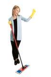 Donna allegra che ha divertimento mentre pulendo Immagine Stock Libera da Diritti