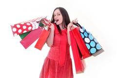 Donna allegra con i sacchetti di acquisto Fotografia Stock Libera da Diritti