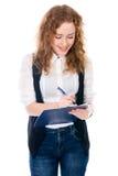 Donna allegra di affari con la penna e compressa per le note Fotografia Stock Libera da Diritti