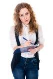 Donna allegra di affari con la penna e compressa per le note Fotografia Stock