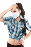 Donna ammalata con la mano della holding di emicrania alla testa Fotografie Stock