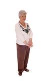 Donna anziana che sta ente completo fotografie stock