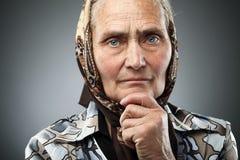 Donna anziana con il kerchief Fotografia Stock Libera da Diritti