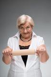 Donna anziana con il matterello Immagine Stock Libera da Diritti