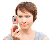 Donna arrabbiata con il telefono Fotografie Stock Libere da Diritti