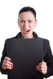 Donna arrabbiata di affari con il dispositivo di piegatura Immagini Stock