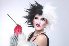 Donna arrabbiata diabolica con capelli pazzi Immagine Stock
