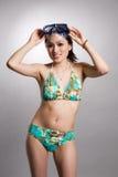 Donna asiatica in bikini Immagini Stock