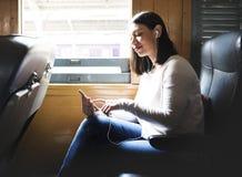 Donna asiatica che guida un treno fotografie stock
