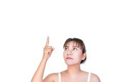 Donna asiatica che indica dito fino a qualcosa Immagine Stock