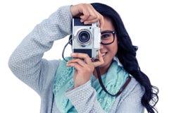 Donna asiatica che prende immagine con la macchina fotografica digitale Immagine Stock