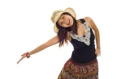 Donna asiatica che presenta un prodotto Immagini Stock