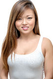 Donna asiatica che sorride nel bianco Fotografie Stock